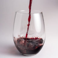 Red wine being poured into a custom designed Bolero Stemless Wine Glass